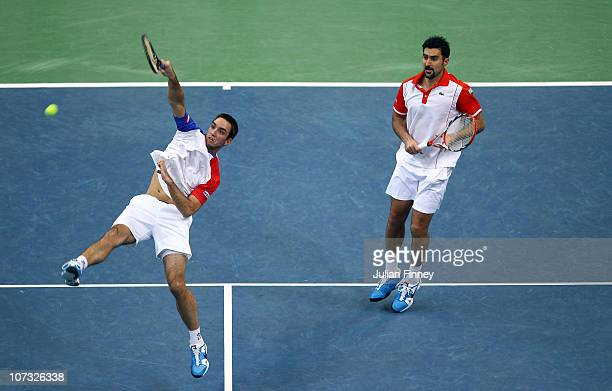 Nenad Zimonjic and Viktor Troicki of Serbia in action in their doubles match against Michael Llodra and Arnaud Clement of France during day two of...