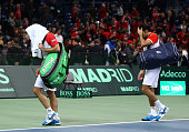 Nenad Zimonjic and Viktor Troicki of Serbia walk off after losing in five sets to Michael Llodra and Arnaud Clement of France in the doubles during...