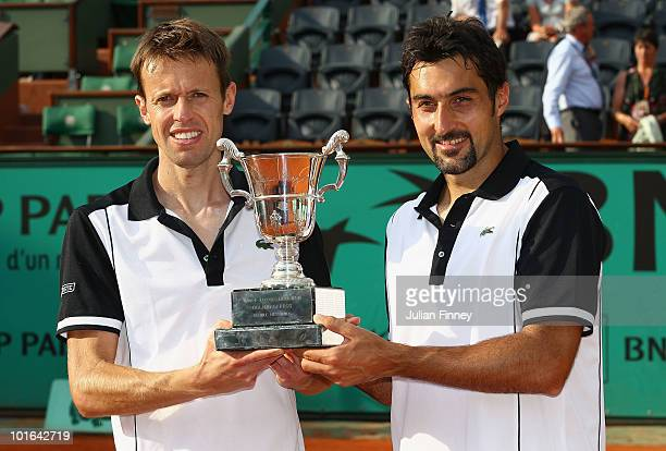 Nenad Zimonjic of Serbia and Daniel Nestor of Canada celebrate with the trophy after their match against Lukas Dlouhy of the Czech Republic and...