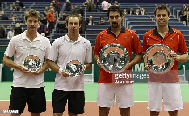 Nenad Zimonjic of Serbia and Daniel Nestor of Canada celebrate with the trophies after defeating Simon Aspelin of Sweden and Paul Hanley of Australia...