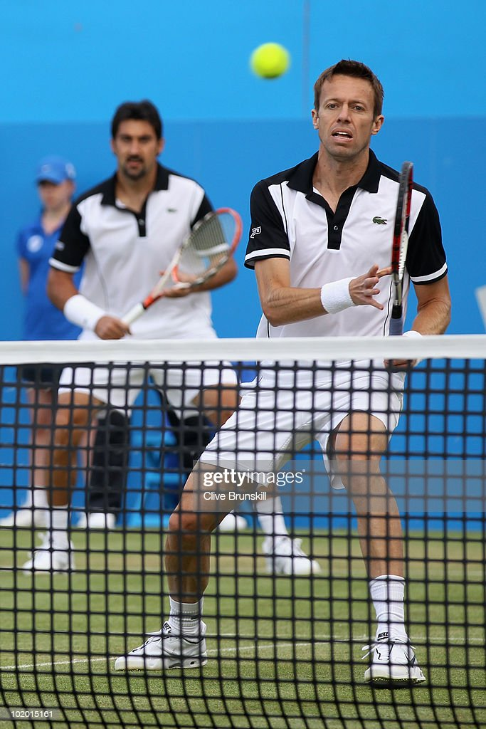 <a gi-track='captionPersonalityLinkClicked' href=/galleries/search?phrase=Nenad+Zimonjic&family=editorial&specificpeople=243242 ng-click='$event.stopPropagation()'>Nenad Zimonjic</a> of Serbia (L) and <a gi-track='captionPersonalityLinkClicked' href=/galleries/search?phrase=Daniel+Nestor&family=editorial&specificpeople=212827 ng-click='$event.stopPropagation()'>Daniel Nestor</a> of Canada during their doubles semi final match against Karol Beck of Slovakia and David Skoch Czech Republic on Day 6 of the the AEGON Championships at Queen's Club on June 12, 2010 in London, England.