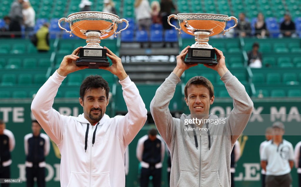 <a gi-track='captionPersonalityLinkClicked' href=/galleries/search?phrase=Nenad+Zimonjic&family=editorial&specificpeople=243242 ng-click='$event.stopPropagation()'>Nenad Zimonjic</a> of Serbia and <a gi-track='captionPersonalityLinkClicked' href=/galleries/search?phrase=Daniel+Nestor&family=editorial&specificpeople=212827 ng-click='$event.stopPropagation()'>Daniel Nestor</a> of Canada with the winners trophy after defeating Max Mirnyi of Belarus and Mahesh Bhupathi of India during day Seven of the ATP Masters Series at the Monte Carlo Country Club on April 18, 2010 in Monte Carlo, Monaco.