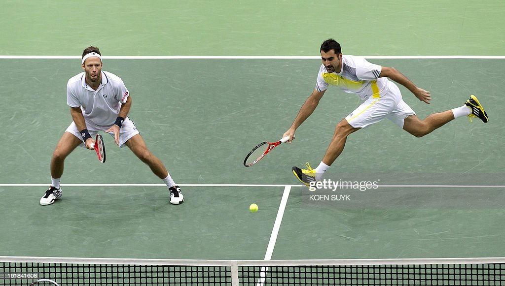 Nenad Zimonjic (R) of Serbia and his teammate Robert Lindstedt of Sweden (L) compete in the double final tennis match against the pair formed by Thiemo de Bakker and Jesse Huta Galung of the Netherlands during the final match of the ATP World Tennis tournament in Rotterdam, on February 17, 2013. Lindstedt and Zimonjic won 5-7, 6-3, 10-8. AFP PHOTO/ANP/ KOEN SUYK netherlands out