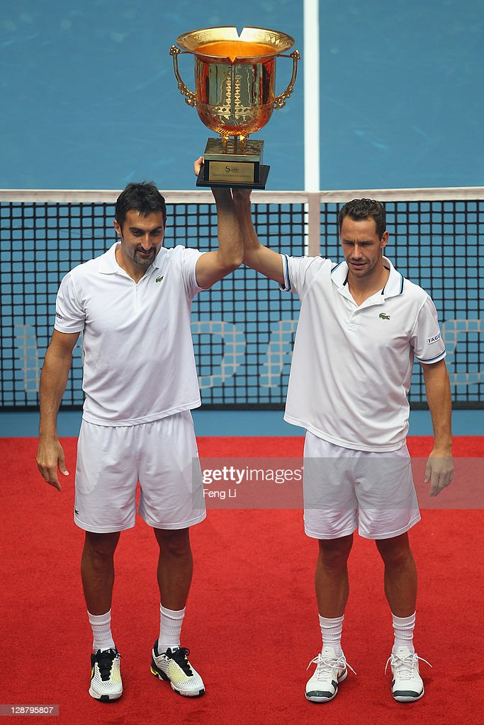 <a gi-track='captionPersonalityLinkClicked' href=/galleries/search?phrase=Nenad+Zimonjic&family=editorial&specificpeople=243242 ng-click='$event.stopPropagation()'>Nenad Zimonjic</a> of Serbia and <a gi-track='captionPersonalityLinkClicked' href=/galleries/search?phrase=Michael+Llodra&family=editorial&specificpeople=208919 ng-click='$event.stopPropagation()'>Michael Llodra</a> of France pose for photographers after winning the men's doubles final of the China Open at the National Tennis Center on October 9, 2011 in Beijing, China.
