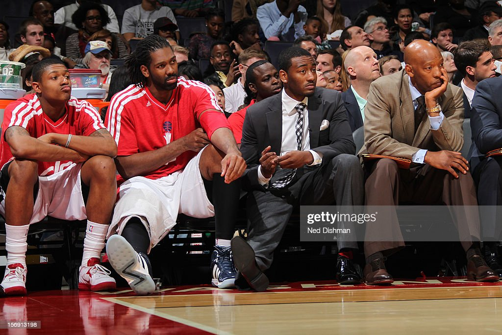 Nene #42 and <a gi-track='captionPersonalityLinkClicked' href=/galleries/search?phrase=John+Wall&family=editorial&specificpeople=2265812 ng-click='$event.stopPropagation()'>John Wall</a> #2 of the Washington Wizards watch from the bench against the Charlotte Bobcats during the game at the Verizon Center on November 24, 2012 in Washington, DC.