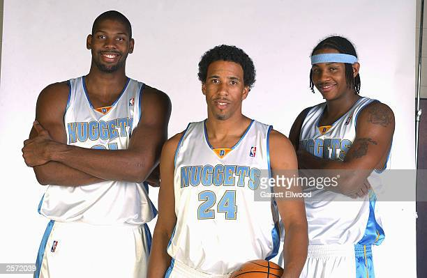 Nene Andre MIller and Carmelo Anthony of the Denver Nuggets pose for a photo during NBA media day at the Pepsi Center on October 2 2003 in Denver...