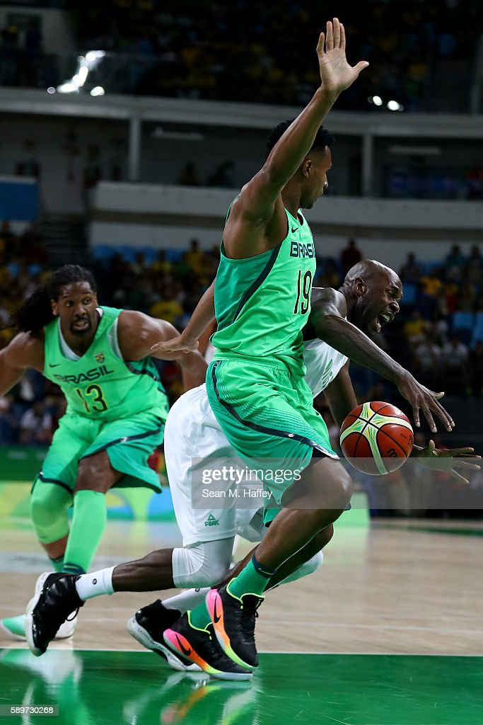 Nene Hilario and Leandro Barbosa of Brazil defend against AlFarouq Aminu of Nigeria during a Men's Preliminary Pool B match on Day 10 of the Rio 2016...