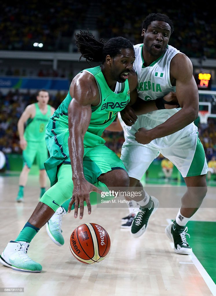 Nene Hilario of Brazil drives past Ike Diogu of Nigeria during a Men's Preliminary Pool B match on Day 10 of the Rio 2016 Olympic Games at Carioca...