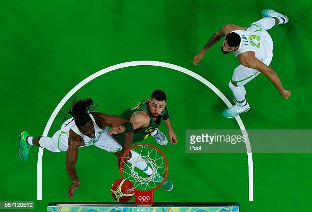 Nene Hilario of Brazil shoots against Antanas Kavaliauskas of Lithuania during a Men's preliminary round basketball game between Brazil and Lithuania...