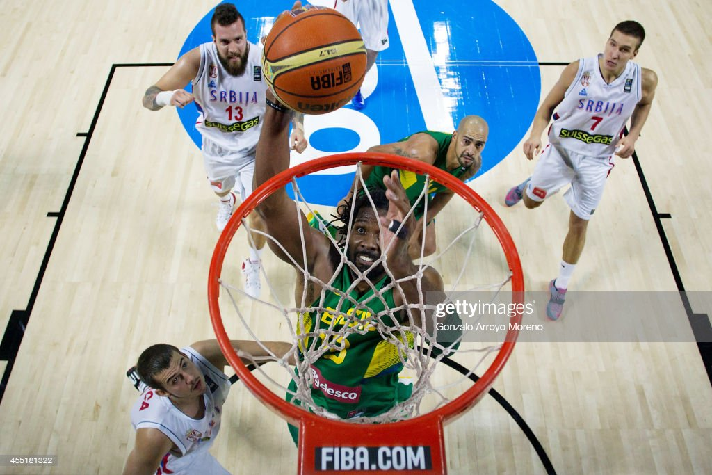 <a gi-track='captionPersonalityLinkClicked' href=/galleries/search?phrase=Nene+Hilario+-+Basketballer&family=editorial&specificpeople=4250456 ng-click='$event.stopPropagation()'>Nene Hilario</a> of Brazil shoots against the Serbians during the 2014 FIBA World Basketball Championship quarter final match between Serbia and Brazil at Palacio de los Deportes on September 10, 2014 in Madrid, Spain.