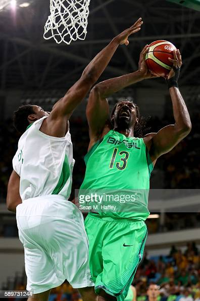 Nene Hilario of Brazil shoots past Ike Diogu of Nigeria during a Men's Preliminary Pool B match on Day 10 of the Rio 2016 Olympic Games at Carioca...