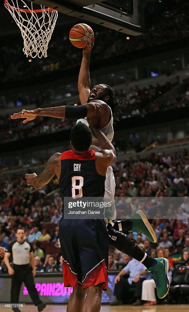 Nene Hilario #13 of team Brazil goes up for a shot over Rudy Gay #8 of team USA during an exhibition game at the United Center on August 16, 2014 in Chicago, Illinois.