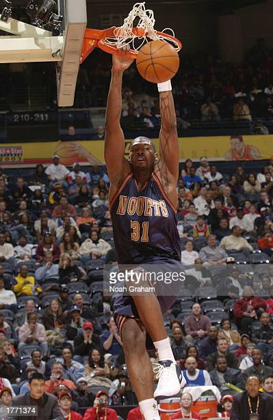 Nene Hilario of the Denver Nuggets dunks during the The Got Milk Rookie Challenge at the 2003 NBA All Star Weekend at Phillips Arena in Atlanta...