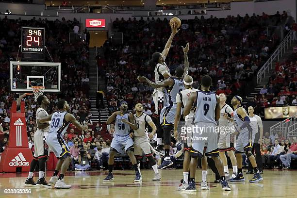 Nene Hilario of the Houston Rockets and JaMychal Green of the Memphis Grizzlies battle for a jump ball at mid court at Toyota Center on January 13...