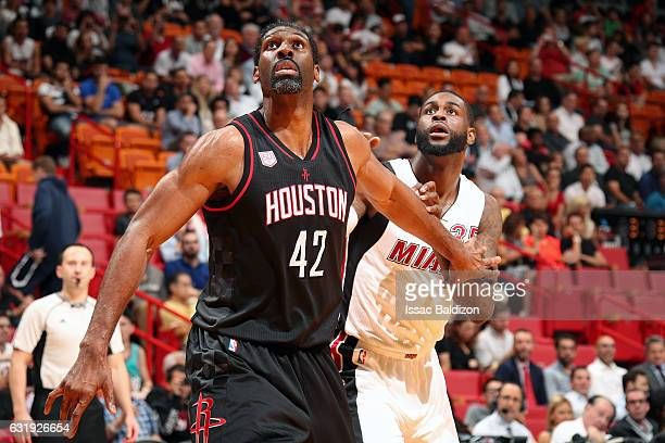 Nene Hilario of the Houston Rockets boxes out against Willie Reed of the Miami Heat during the game on January 17 2017 at AmericanAirlines Arena in...