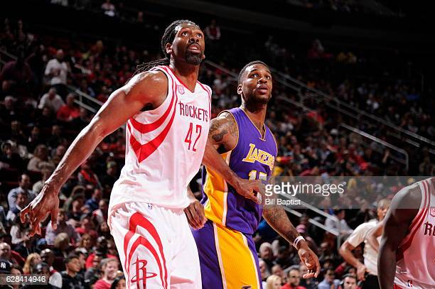 Nene Hilario of the Houston Rockets boxes out Thomas Robinson of the Los Angeles Lakers on December 7 2016 at the Toyota Center in Houston Texas NOTE...