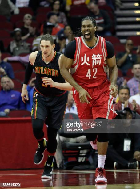 Nene Hilario of the Houston Rockets celebrates after a dunk in the first half at Toyota Center on February 2 2017 in Houston Texas NOTE TO USER User...