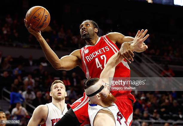 Nene Hilario of the Houston Rockets drive to the basket over Aron Baynes of the Detroit Pistons during the second half at the Palace of Auburn Hills...