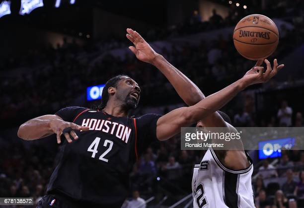 Nene Hilario of the Houston Rockets drives against LaMarcus Aldridge of the San Antonio Spurs during Game Two of the NBA Western Conference...