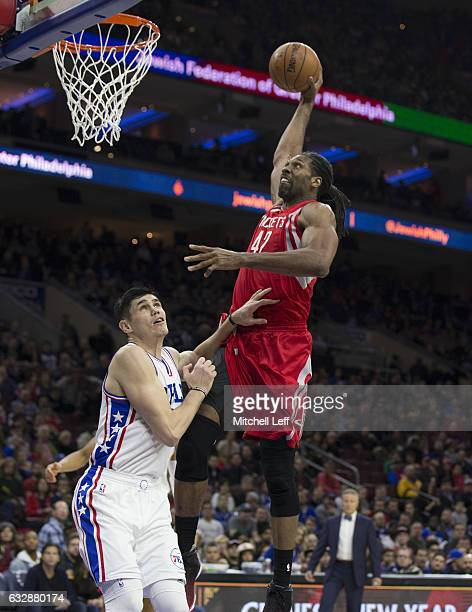 Nene Hilario of the Houston Rockets dunks the ball against Ersan Ilyasova of the Philadelphia 76ers in the third quarter at the Wells Fargo Center on...