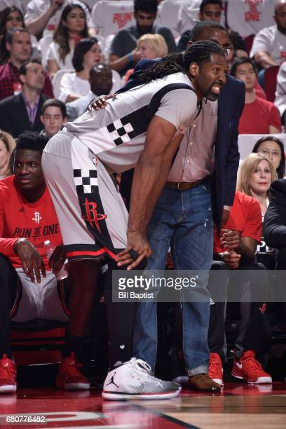 Nene Hilario of the Houston Rockets gets treatment on the bench during Game Four of the Western Conference Semifinals against the San Antonio Spurs...