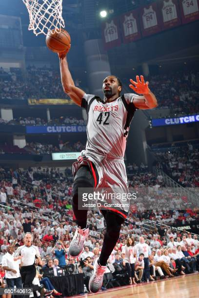 Nene Hilario of the Houston Rockets goes for a dunk during the game against the San Antonio Spurs during Game Four of the Western Conference...
