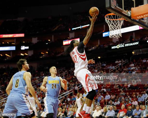 Nene Hilario of the Houston Rockets goes up for a lay up defended by Mason Plumlee of the Denver Nuggets and Danilo Gallinari in the first half at...
