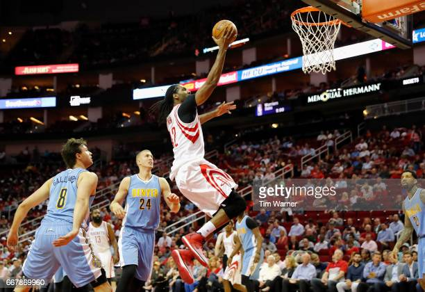 Nene Hilario of the Houston Rockets goes up for a layup trailed by Danilo Gallinari of the Denver Nuggets and Mason Plumlee in the first half at...