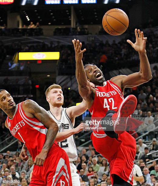 Nene Hilario of the Houston Rockets is fouled by Davis Bertans of the San Antonio Spurs as he grabs a rebound at ATT Center on November 9 2016 in San...
