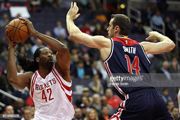Nene Hilario of the Houston Rockets is guarded by Jason Smith of the Washington Wizards during the first half at Verizon Center on November 7 2016 in...