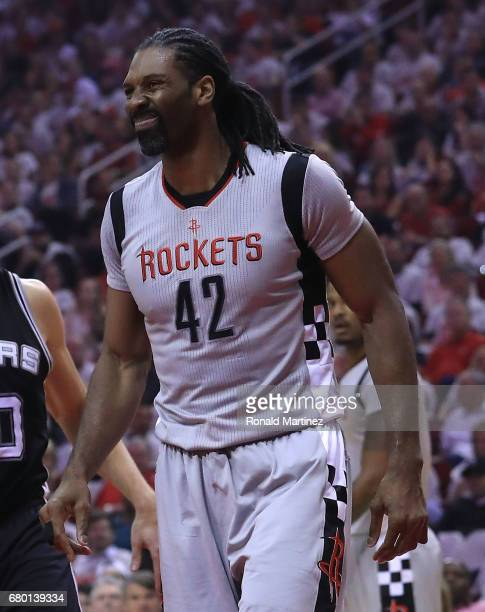 Nene Hilario of the Houston Rockets reacts after he was charged with a foul against Jonathon Simmons of the San Antonio Spurs during Game Three of...
