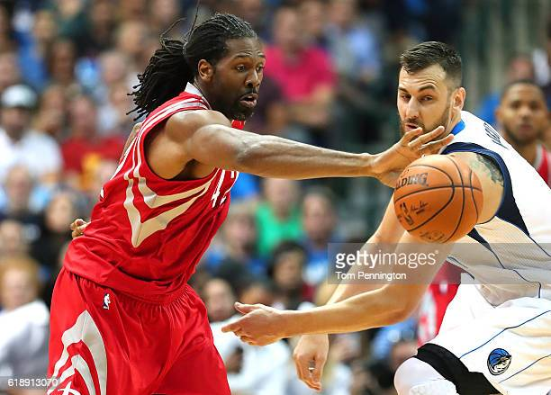 Nene Hilario of the Houston Rockets scrambles for the ball against Andrew Bogut of the Dallas Mavericks in the first half at American Airlines Center...