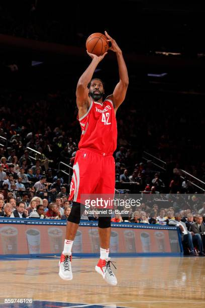 Nene Hilario of the Houston Rockets shoots the ball against the New York Knicks during the preseason game on October 9 2017 at Madison Square Garden...