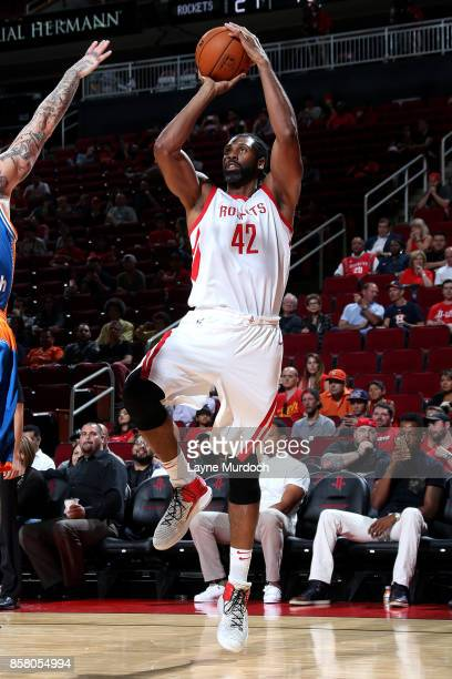 Nene Hilario of the Houston Rockets shoots the ball during the preseason game against the Shanghai Sharks on October 5 2017 at the Toyota Center in...