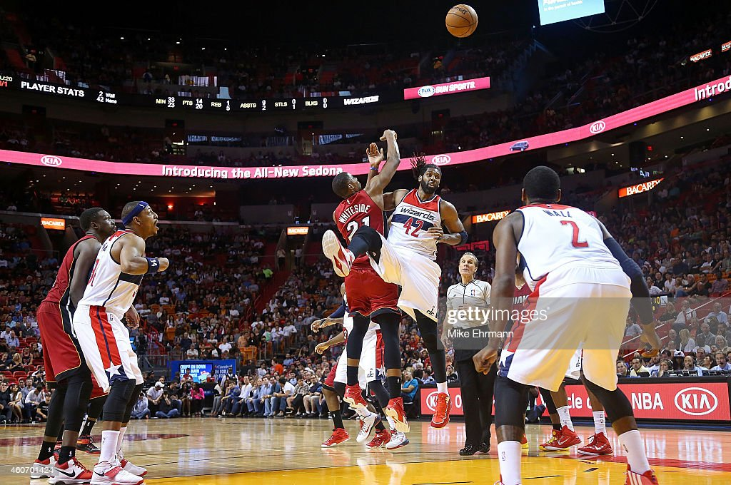 Nene Hilario #42 of the Washington Wizards and Hassan Whiteside #21 of the Miami Heat jump ball during a game at American Airlines Arena on December 19, 2014 in Miami, Florida.