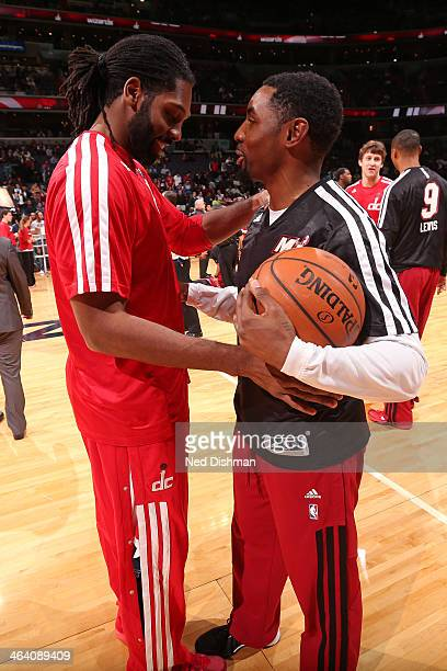 Nene Hilario of the Washington Wizards and Roger Mason Jr #21 of the Miami Heat shake hands before the game at the Verizon Center on January 15 2014...
