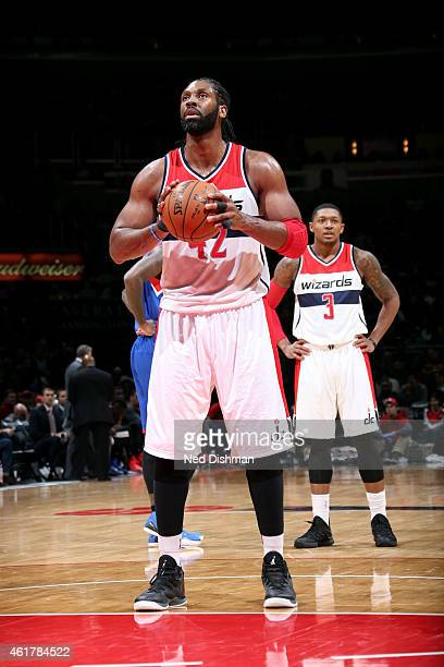 Nene Hilario of the Washington Wizards attempts a free throw against the Philadelphia 76ers on January 19 2015 at Verizon Center in Washington DC...