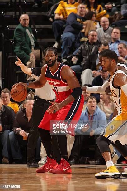 Nene Hilario of the Washington Wizards controls the ball against the Indiana Pacers at Bankers Life Fieldhouse on January 10 2014 in Indianapolis...