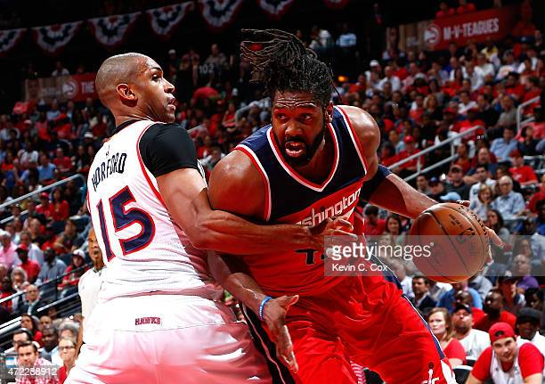 Nene Hilario of the Washington Wizards drives against Al Horford of the Atlanta Hawks during Game Two of the Eastern Conference Semifinals of the...