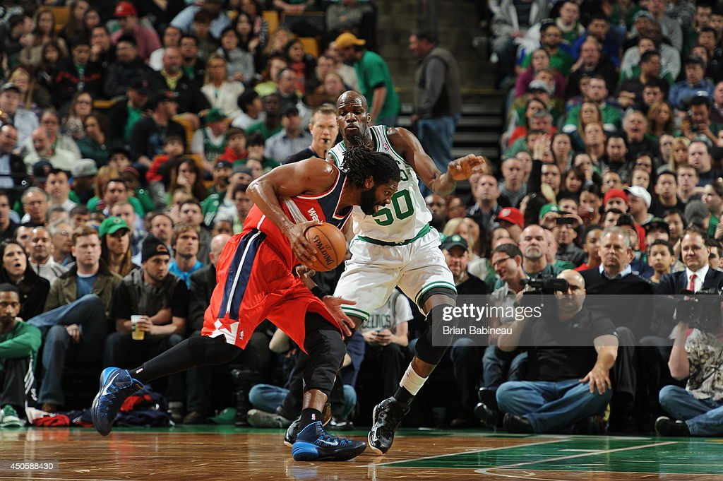 Nene Hilario #42 of the Washington Wizards drives against Joel Anthony #50 of the Boston Celtics on April 16, 2014 at the TD Garden in Boston, Massachusetts.