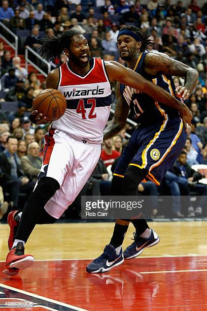 Nene Hilario of the Washington Wizards drives around Jordan Hill of the Indiana Pacers in the first half at Verizon Center on November 24 2015 in...