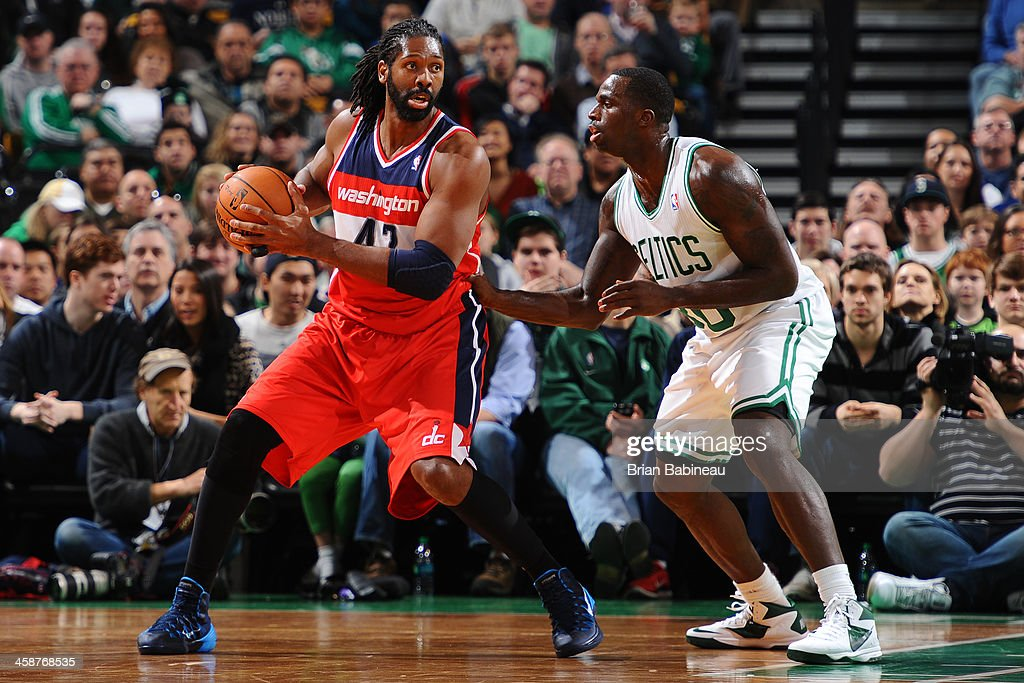 Nene Hilario #42 of the Washington Wizards drives to the basket against the Boston Celtics on December 21, 2013 at the TD Garden in Boston, Massachusetts.