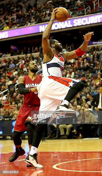 Nene Hilario of the Washington Wizards drives to the basket against Henry Walker of the Miami Heat during the second half of their 9997 win at...