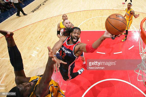 Nene Hilario of the Washington Wizards drives to the basket against the Indiana Pacers during a game at the Verizon Center on March 25 2015 in...