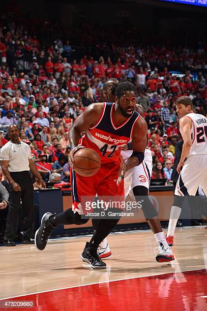 Nene Hilario of the Washington Wizards drives to the basket against the Atlanta Hawks in Game five of the Eastern Conference Semifinals of the NBA...