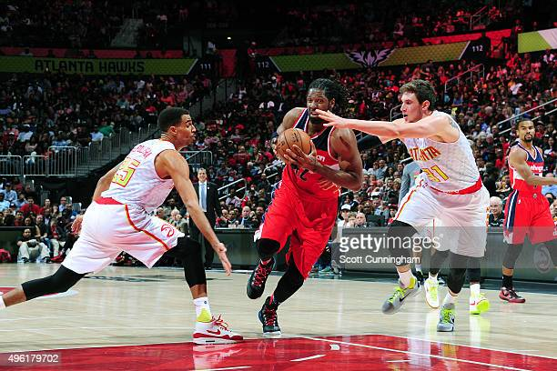Nene Hilario of the Washington Wizards drives to the basket against the Atlanta Hawks during the game on November 7 2015 at Philips Arena in Atlanta...