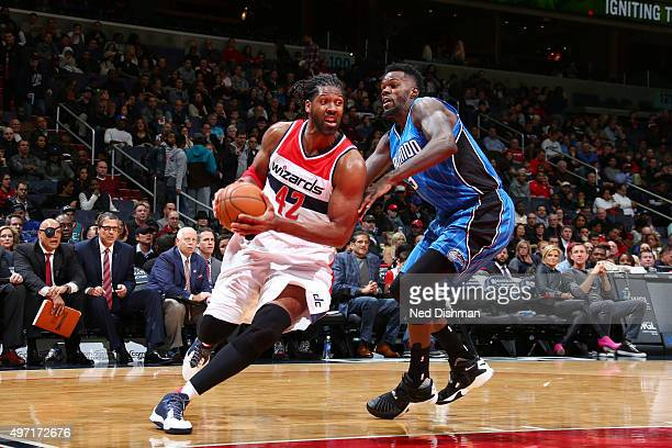 Nene Hilario of the Washington Wizards drives to the basket against the Orlando Magic during the game on November 14 2015 at Verizon Center in...