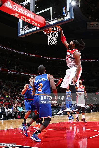 Nene Hilario of the Washington Wizards dunks against New York Knicks during the game on October 31 2015 at Verizon Center in Washington DC NOTE TO...