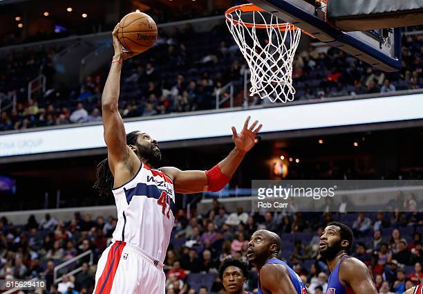 Nene Hilario of the Washington Wizards dunks against the Detroit Pistons in the second half at Verizon Center on March 14 2016 in Washington DC NOTE...