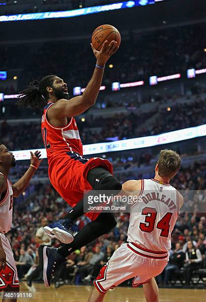 Nene Hilario of the Washington Wizards goes up shot a shot over Mike Dunleavy of the Chicago Bulls at the United Center on March 3 2015 in Chicago...